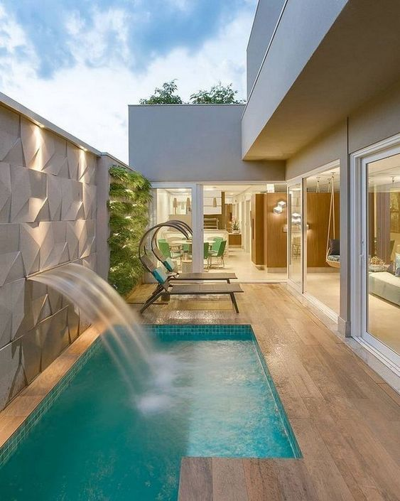 Swimming Pool with Waterfalls Ideas: Simple and Decorative